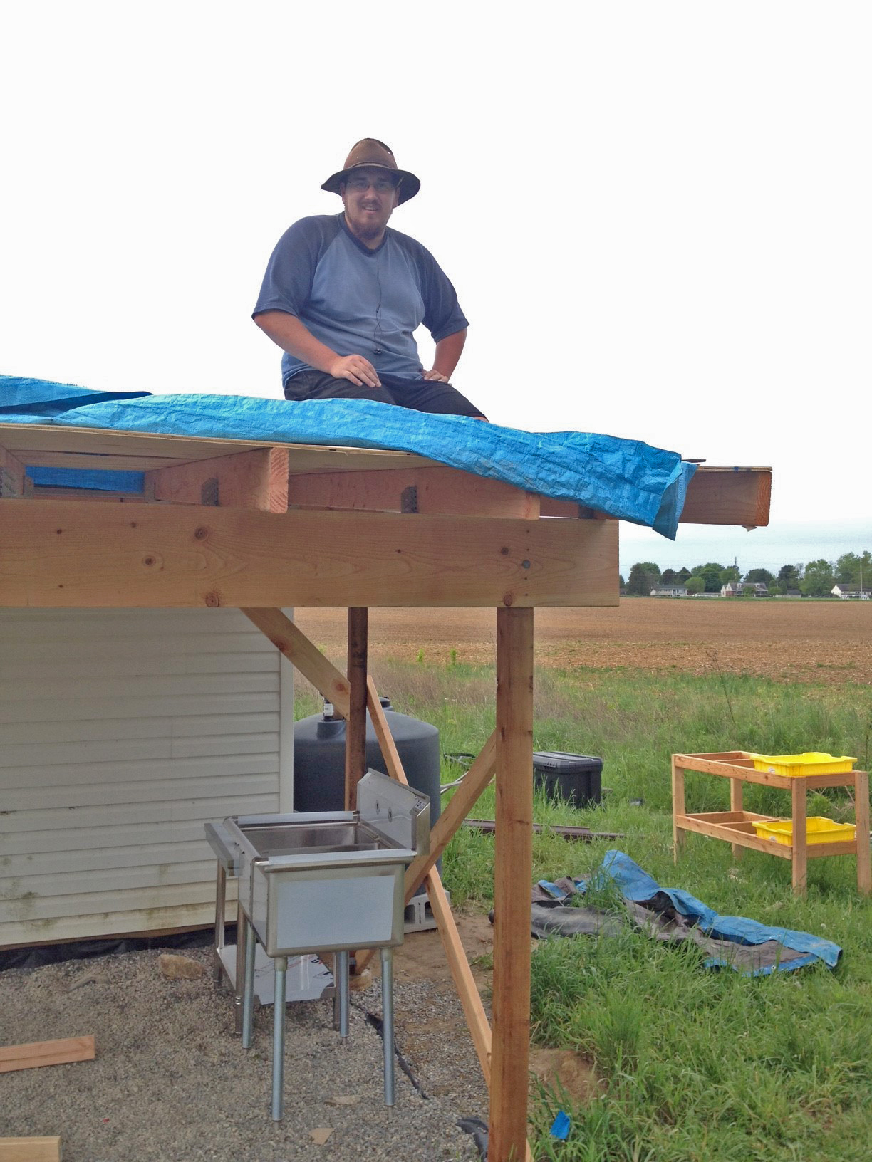 Brandon surveys the roof frame