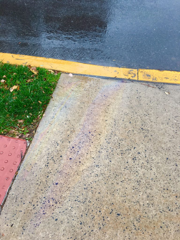 Multiphase flow (oily sheen) in runoff near Bailey Health Center  - submitted by James Roberts