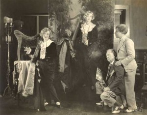 """25:4  Christy paints actress Marion Davies, at left, in her costume from the film """"Little Old New York.""""  Painting commissioned by Sid Grauman, right, for the Chinese Theater in Los Angeles, California, 1925."""