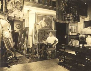 40:4  The artist in his Hotel des Artistes Studio, New York City.  At left, portrait of Will Hayes.  Above, self-portrait.