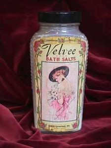 Box 64, Tray 2, Compartment 1  Velvee Rose Bath Salt glass jar featuring portrait of Nancy Palmer Christy by Howard Chandler Christy on label.