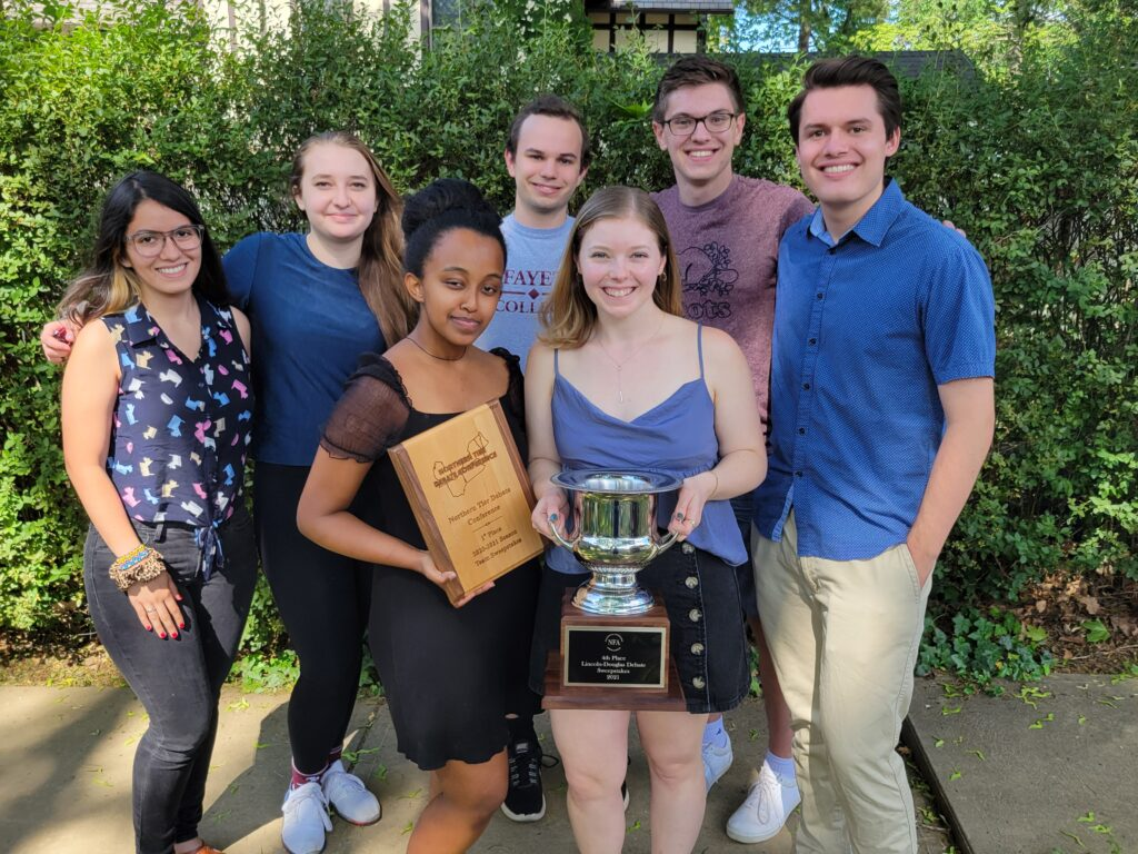 From Left, top: Andrea Rivera Conte, Ceci Montufar, Ben Herman, Jacob Moldover, Joshua Hulon Hale. Bottom, center: Yordanos Mengistu, Luisa Gunn holding the NTDC 1st place team award and the 4th place debate sweepstakes award from NFA Nationals
