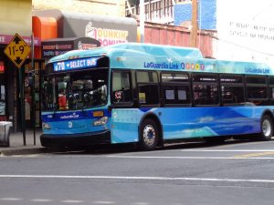 A bus in blue livery on a street