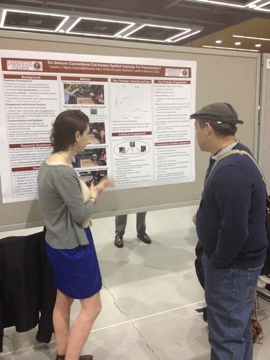 Rachel LeWitt '13 explains findings from gesture research to a colleague at the Society for Research in Child Development in Seattle, held in April 2013.