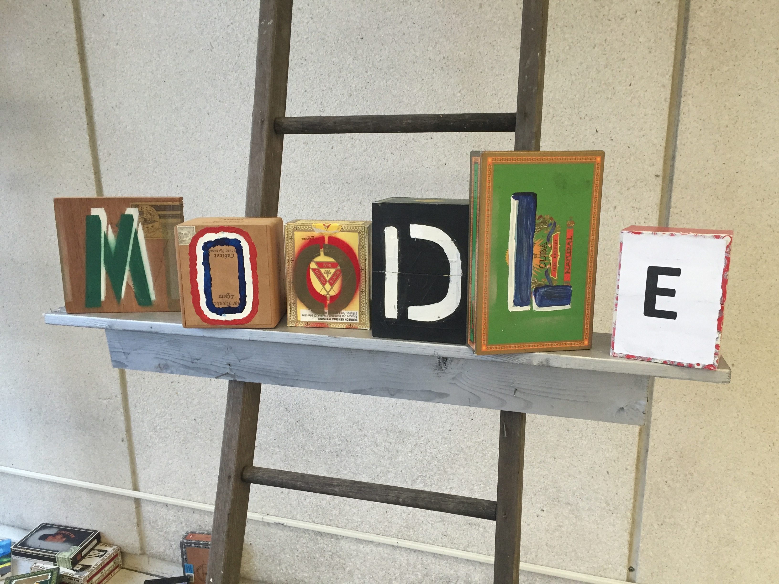 "Stylized art blocks comprise the word ""Moodle"""